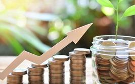 Dòng tiền dồi dào, vốn đầu tư dồn về bất động sản và chứng khoán